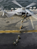 Marines Prepare to Board an MH-60S Sea Hawk Helicopter Aboard USS Peleliu Photographic Print by  Stocktrek Images