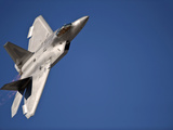 An F-22 Raptor Aircraft Performs During Aviation Nation 2010 Photographic Print by  Stocktrek Images