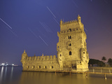 The Sirius Star and Constellation Orion Setting Behind the Bélem Tower in Lisbon, Portugal Photographic Print by  Stocktrek Images