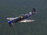 A Supermarine Spitfire MK-18 in Flight Photographic Print by  Stocktrek Images