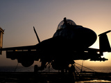 Silhouette of a US Navy F/A-18E Super Hornet on the Flight Deck of USS Nimitz Photographic Print by  Stocktrek Images