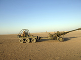 A 105MM Light Gun Being Towed by an All-Terrain Vehicle Photographic Print by  Stocktrek Images