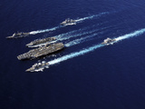 The Abraham Lincoln Carrier Strike Group Ships Cruise in Formation in the Pacific Ocean Photographic Print by  Stocktrek Images