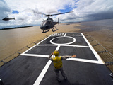 A Brazilian Eurocopter Prepares to Land Aboard a Brazilian Navy Hospital Ship Photographic Print by  Stocktrek Images