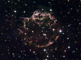 A Detailed View at the Tattered Remains of a Supernova Explosion known as Cassiopeia A Photographic Print by  Stocktrek Images