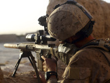 U.S. Marine Looks Through the Scope of His M16A4 Rifle for Enemy Forces Photographic Print by  Stocktrek Images