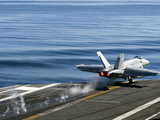 An F/A-18E Super Hornet Launches from the Flight Deck of USS Carl Vinson Photographic Print by  Stocktrek Images