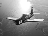 A Grumman F8F Bearcat in Flight Photographic Print by  Stocktrek Images