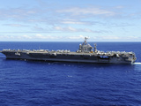 The Aircraft Carrier USS Abraham Lincoln Transits across the Pacific Ocean Stampa fotografica di Stocktrek Images,