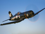 A Vought F4U-5 Corsair in Flight Photographic Print by  Stocktrek Images