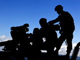 Silhouette of Soldiers Operating a BGM-71 Tow Guided Missile System Photographic Print by  Stocktrek Images