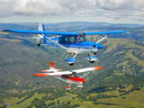 Two Champion Aircraft Citabrias in Flight Photographic Print by  Stocktrek Images
