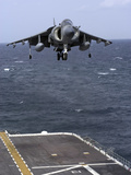 An AV-8B Harrier II Prepares to Land on the Flight Deck of USS Nassau Photographic Print by  Stocktrek Images