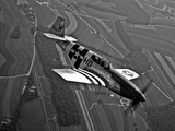 A P-51C Mustang in Flight Photographic Print by  Stocktrek Images