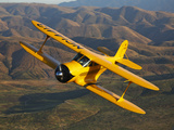 A Beechcraft D-17 Staggerwing in Flight Photographic Print by  Stocktrek Images
