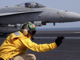 A Shooter Launches an F/A-18E Super Hornet from USS Ronald Reagan Stampa fotografica di Stocktrek Images,