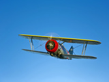 A Grumman F3F Biplane in Flight Photographic Print by  Stocktrek Images