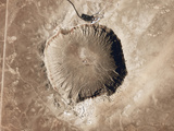 A Meteorite Impact Crater in the Northern Arizona Desert of the United States Photographic Print by  Stocktrek Images