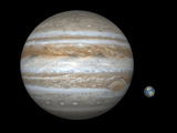 Artist's Concept Comparing the Size of the Gas Giant Jupiter with That of the Earth Photographie par  Stocktrek Images