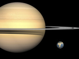 Illustration of Saturn and Earth to Scale Photographic Print by  Stocktrek Images