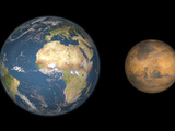 Artist's Concept Comparing the Size of Mars with That of the Earth Photographic Print by  Stocktrek Images