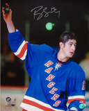 Brandon Dubinsky Autographed Rangers Blue Jersey Holding Up The Puck Vertical Photograph Photo