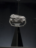 A 4.7. Ounce Moon Rock Photographic Print by Tyrone Turner