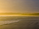 Small Waves Caress a Wide Beach in an Ocean Bay at Sunset Photographic Print by Jason Edwards