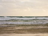 Storm Clouds Reflect Pastel Colors in Rough Waves Rolling into Shore Photographic Print by Jason Edwards