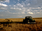 A Landscape of an Old Farm Truck in a Field at Sunset Photographic Print by Kenneth Ginn