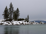Scenic Snow Covered Rocks and Evergreens on the Shore of Lake Tahoe Photographic Print by Charles Kogod