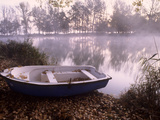 A Boat on the Shore of Misty Lake Banyoles Photographic Print by Tino Soriano