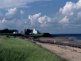 A Lighthouse Marks the North East Point, Prince Edward Island, Canada Photographic Print by Kenneth Ginn