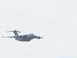 A United States Air Force C-17 Globemaster in Flight Photographic Print by Raul Touzon