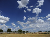 Cloud Formations in a Blue Sky Above a Horse Ranch Photographic Print by Raul Touzon