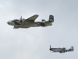 A B-25 Mitchell and a P-51 Mustang in Flight Photographic Print by Raul Touzon