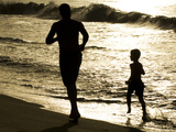 Father and Son Run on Grande Riviere Beach at Sunset Photographic Print by Mauricio Handler