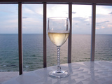 A Glass of White Wine on the Balcony of a Condo at Gulf Shores Fotografie-Druck von National Geographic Photographer