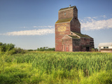 A Derelict Grain Elevator Weathers Away on the Canadian Prairie Photographic Print by Pete Ryan