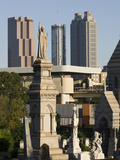 Morning Light on Tombs in the Oakland Cemetery with Atlanta Skyline Fotografiskt tryck av Krista Rossow