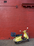 A Yellow Motor Scooter Against a Red Wall in Little Five Points Fotografiskt tryck av Krista Rossow