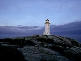 A Light House Near Peggy's Cove in Nova Scotia Photographic Print by Kenneth Ginn