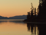 Calm Bay at Sunset Surrounded by Boreal Forest, Southeast Alaska Photographic Print by Flip Nicklin/Minden Pictures