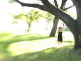 A Young Woman in an Oak Forest Photographic Print by Raul Touzon