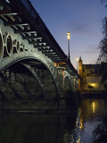 The Bridge of Triana, Puente De Triana, Illuminated at Night Fotografiskt tryck av Krista Rossow