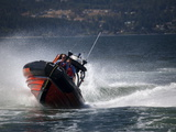 A Canadian Coast Guard Search and Rescue Zodiac Boat in Action Photographic Print by Pete Ryan