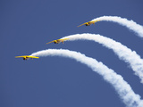 Three Yellow Planes Leave Arcs of White Smoke Behind Photographic Print by Pete Ryan