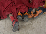 Western Boots on Three Young Monks at the Karsha Gustor Festival Photographic Print by Steve Winter