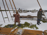 Komi Tribespeople Erect the Poles of their Reindeer-Skin Chum Photographic Print by Gordon Wiltsie