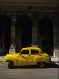 An Old Yellow Car Sits at the Curb in Old Havana Photographic Print by Kenneth Ginn